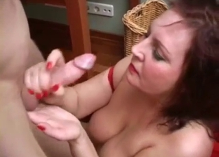 Busty mom is sucking my dick on the knees