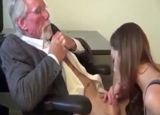 Elegant granddaughter blows her lucky grandpa