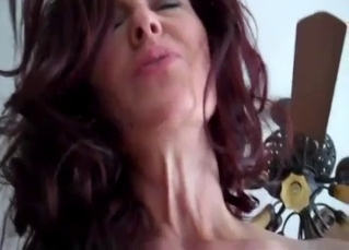 Redhead mom gives a perfect footjob