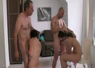 Daughter and mom are blowing two loaded cocks